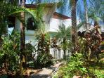 Casa Terraza - apartment is located on ground floor, picture shows pathway to house and apartment