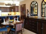 fully furnished dining and kitchen, with plates, utensils, cookware