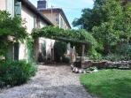 Looking from the front of the gîte, towards the bridge over the millstream and the main house
