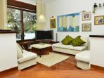Spacious living room with comfortable sofas and flat screen TV