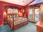 One of the 2 master bedroom suites