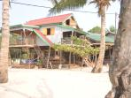 On M'Pai Bay beachfront, the main house has 2 en-suite rooms - sleeping 2 and 4, so up to 6 as one.