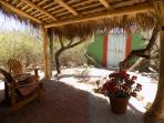 Sitting area under shaded palapa