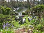 Terraced garden down to the Gorge waterway with a dock and view of all the activity.