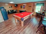 Game room with pool table, air hockey, multi-cade, fridge and blutooth player.