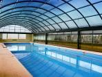 Our swimming pool 5 minutes away from the house. Piscina 5 minutos desde la casa.  Hay Bar y Terraza