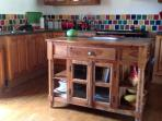 Kitchen with large range cooker, dishwasher and microwave