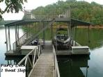 The dock with boat lift, 2 decks, and jet ski ports