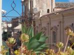 Vista dal terrazzo.  Chiesa di San Carlo e convento dei Gesuiti
