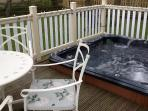 South facing sunken hot tub with umberella for all year round use