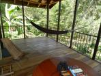 Hangout on your private deck - lounging in the hammock or bird watching!