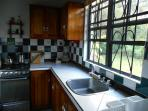 Studio Kitchen area complete with full sized fridge, gas stove and oven. Lots of cupboard space.