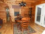 Dining table seats 6.  Has French doors to deck with mountain views.