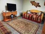 Game room with daybed with pull-out trundle,, TV and Karaoke machine.