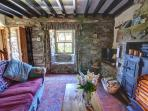 Plenty of character with beams, stone walls and open fire