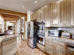 Stainless steel appliances pair nicely with the granite counter tops.
