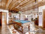 Downstairs game room with pool table