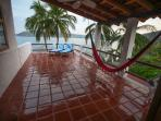 Upper House patio,  panoramic view of the Bay. Enjoy the sun or shade. Ceiling fan over the hammock