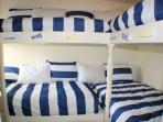 The cove, 4 twin beds and a small TV