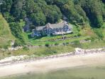 Aerial view of home from beach on Buzzards Bay