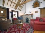 Pembrokeshire Strumble Head cosy cottage - sitting room with wood burning stove
