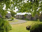 Fishguard coastal holiday cottage tranquil setting - courtyard gardens