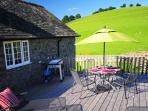 Decking at back of property with portable barbecue