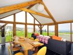 Harlech holiday cottage - Conservatory with panoramic views of Cardigan Bay to Snowdonia