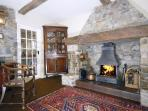 Town house in Aberaeron - dining room with original open fireplace