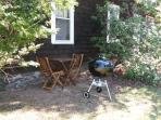 Outdoor table, chairs, and 22 inch Weber charcoal grill