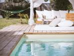 The relax zone with heated pool and gazebo
