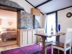 Living/dining room, small oak dining table for two.