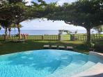 Looking out from covered veranda, Pool has a Beach Entry and infinity Edge towards ocean.