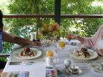 Guests enjoying their GF/Vegetarian breakfasts on Dining Deck overlooking Pool and Bay.