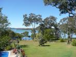 View from Yarrandabbi Dreaming over lawn to Perulpa Bay and North Stradbroke Island.