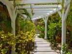 pergola walkway towards Master bungalow