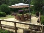Lovely enclosed wild garden with sofa seating, BBQ and dining area