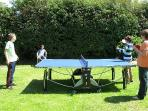 Table tennis in the garden for family tournaments