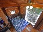 From the double/full size bed in the loft... down to the queen size murphy bed... the east window