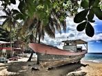 Quaint fishing boat being restored (Castara Beach).