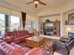 GREAT ROOM WITH 60' TV WONDERFUL CONVERSATION AREA LOOKING OUT AT THE POOL/SPA