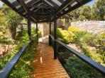 Walk across the bridge over the lush tropical gardens as Pearl River House