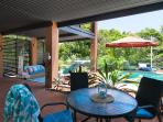 Outdoor dining on rear terrace overlooking the pool and outdoor lounge area (ground floor)