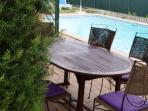 Teak table and metal chairs