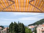 Sea view from the terrace with awning