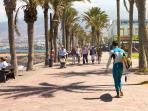 surfer beach and promenade of las americas
