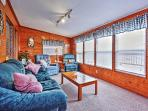 Cuddle up in the cozy den and observe marvelous views overlooking the water