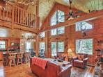 After a day of outdoor activities, you'll look forward to relaxing in this  log home.