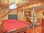 Have fun game nights with this  pool table in the basement!