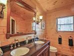 Rinse off for the day in this bathroom with double vanities.